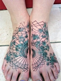 Beautiful abstract tattoo on feet by Toko Loren