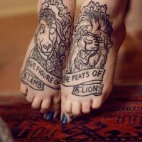 Black lines animal heads tattoo on feet