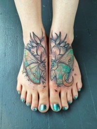 Colorful butterfly tattoo on feet by Mike Moses