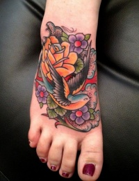 Colorful old school swallow tattoo on foot by Luke Wessman
